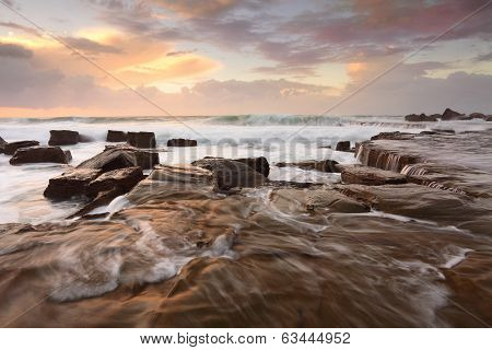Ocean Surf And Overflows At Sunrise
