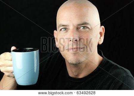 Peaceful Bald Man Lifts Mug To Camera