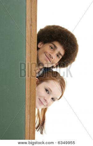 Smiling Teens With Blank Chalkboard