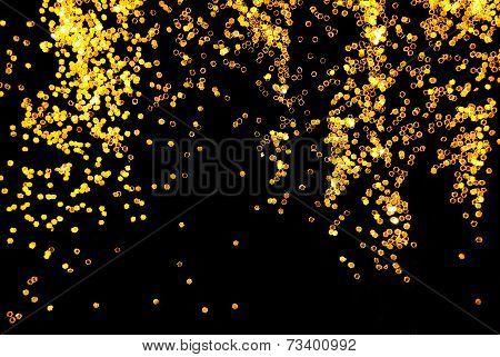 golden glitter sparkle on black