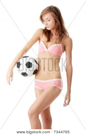 Young Woman With A Football Ball