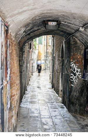 A rainy back street in Venice, Italy