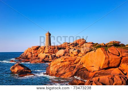 Ploumanach Mean Ruz lighthouse red sunset in pink granite coast Perros Guirec Brittany France poster