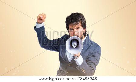 Man Shouting Over Ocher Background