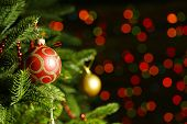 Decorated Christmas tree on  blurred, sparkling and fairy background poster