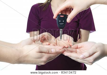 A hand give key to other person. if you drink don't drive