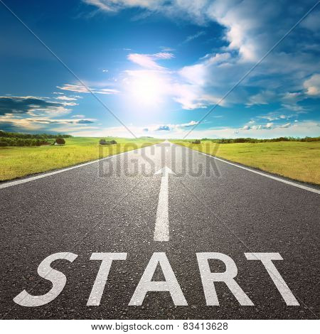 Empty Asphalt Road With A Sign Start Against Sun