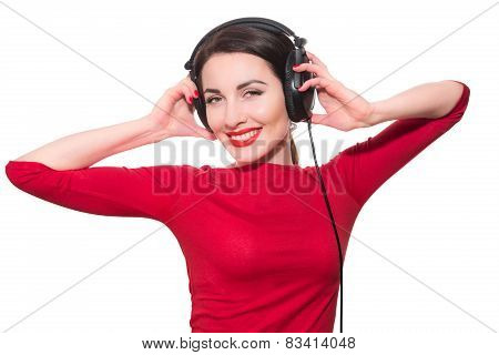 Wonderful Teenager Girl  Listening To The Music In Big Headphones In Red Clothes Islolated