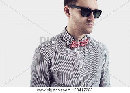 Young man hipster  with bow tie sunglasses confident certained, serious look.