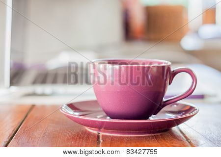 Purple Coffee Cup On Work Station