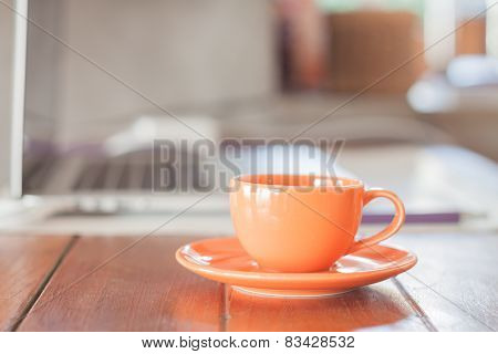 Mini Orange Coffee Cup On Work Station