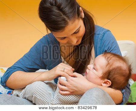 Young Mother With Her Baby
