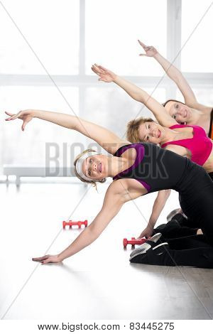 Group Of Women Doing Fitness Training In Class