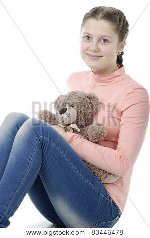 Portrait Of Pretty Little Girl Holding Teddy Bear On White