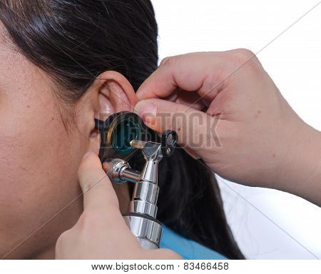 Ent Physician Checking Patient's Ear Using Otoscope With An Instrument