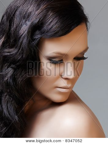 beautiful woman with long black hair looking down poster