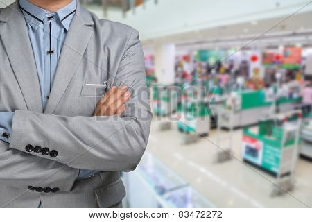 Business Man stand in Hypermarket or Supermarket store present retail marketing poster