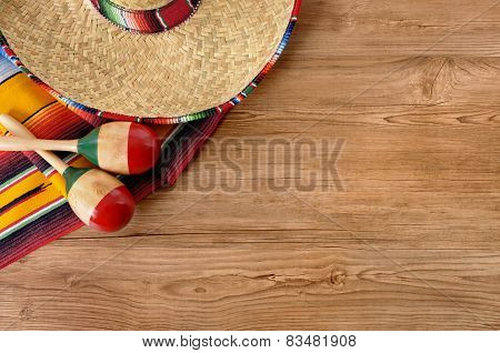 Mexican Sombrero And Blanket On Pine Wood Floor