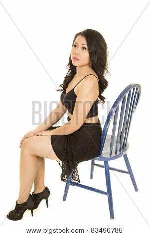 Asian Woman In A Black Skirt Sitting On A Blue Chair Look Up