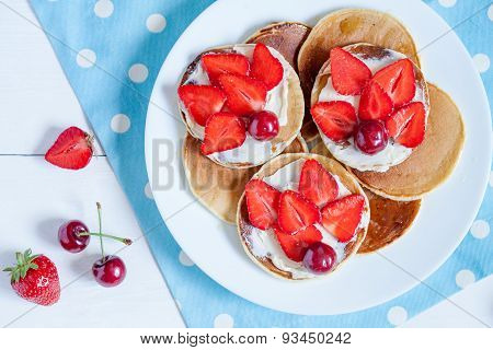 Delicious pancakes morning sweet dessert food with fruits and butter on provence style background
