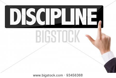 Businessman pressing button with the text: Discipline