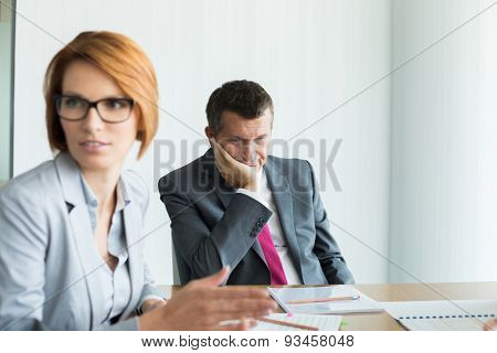 Bored businessman in conference meeting