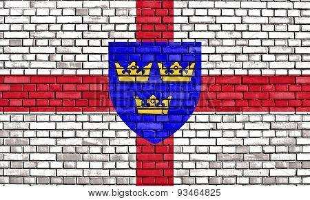 Flag Of East Anglia Painted On Brick Wall