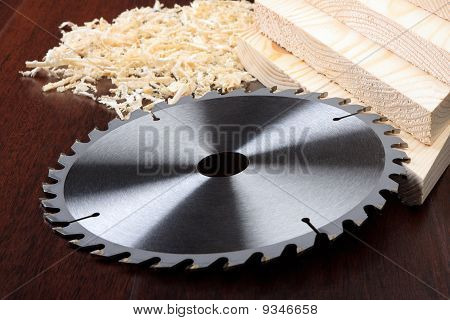 Circ Saw Blades, Planks And Shavings On Dark Background