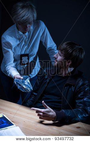 Police Officer Interrogates A Man