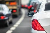 Rush hour traffic congestion focus on tail brake light poster