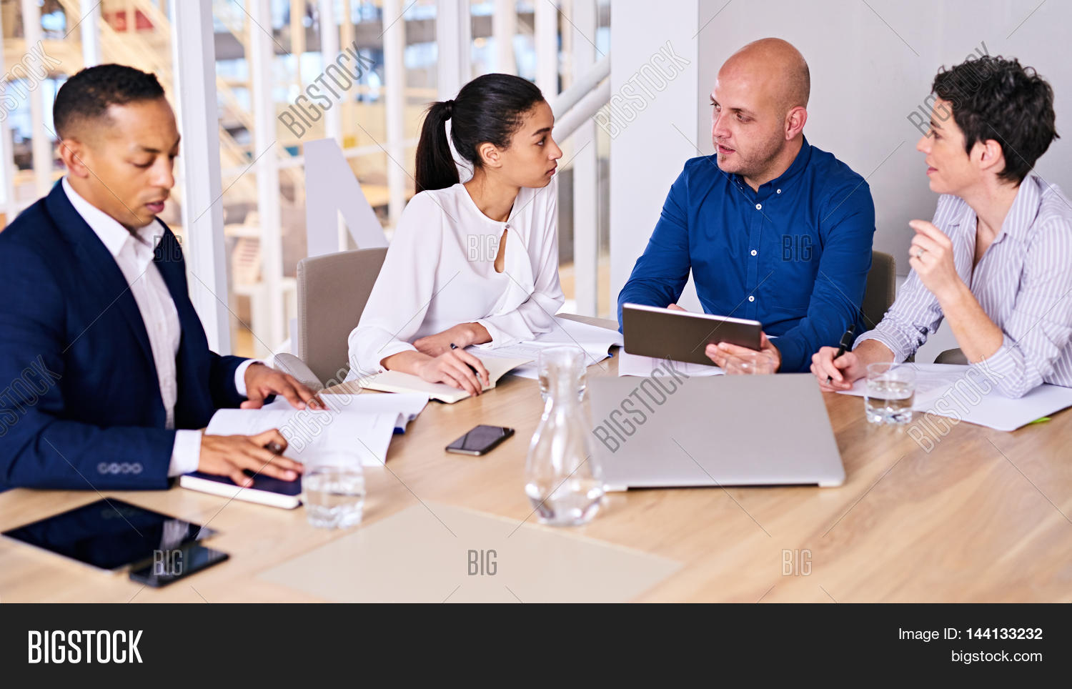 office meeting. Young Diverse And Dynamic Group Of Eclectic Multiethnic Individual Business People Busy Conducting A Meeting In Office