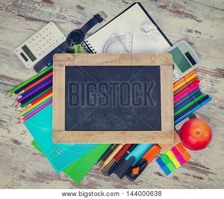 Empty Chalkboard hero header with copy space and school supplies, retro toned