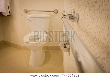 disabled toilet bathroom with grab bars in white interior design hotel