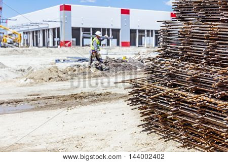 Spikes of rebar grid reinforcing mesh steel bars stacked for construction.