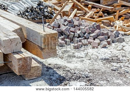 Various type of goods for different usage are selected and piled construction site in the improvised warehouse stockpile.