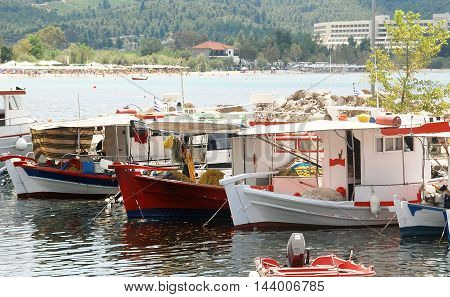 Small marine full off fishing boats and speedboats
