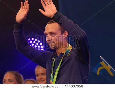 STOCKHOLM SWEDEN - AUG 21 2016: Happy swedish male skeet shooter Marcus Svensson when swedish olympic athletes are celebrated in Kungstradgarden StockholmSwedenAugust 212016