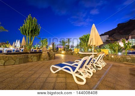 TAURITO, GRAN CANARIA, SPAIN - APRIL 23, 2016: Pool area of Paradise Lago Taurito hotel at night, Gran Canaria, Spain. Paradise is 4 hotels complex of very popular tourist destination on Gran Canaria.