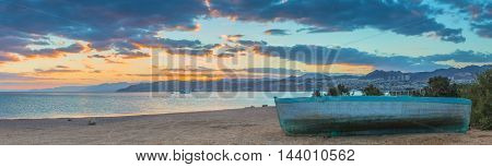Coastal landscape with old fishing boat, Red Sea, Israel