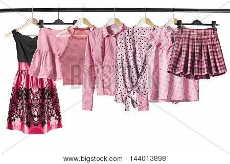 Set of pink clothes on clothes racks isolated over white