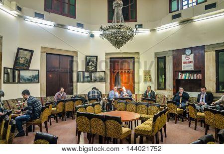 Istanbul, Turkey - April 4, 2013: Hookah house near Beyazıt Square, Istanbul. Turkish people smoke hookah (Nargile) in cafe