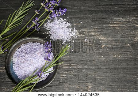 Bath salts herbal body care product with fresh lavender on rustic wooden background, copy space