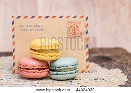 Macarons in front of vintage envelope with par avion or air mail