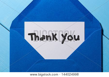 Letter with the words thank you at blue envelope.