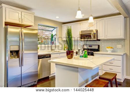 Modern Kitchen Room Interior With White Cabinets, Stainless Steel