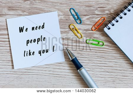 We need people like you written on peace of paper on human resources manager workplace .