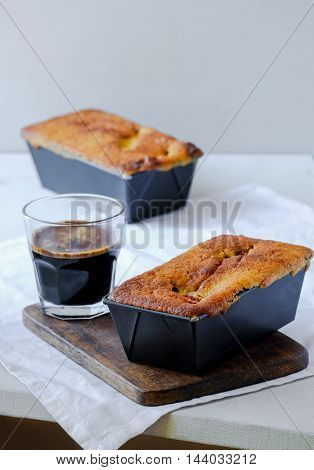 Vanilla Mini Coffee Pound Cakes in Baking Tins with Freshly Brewed Coffee