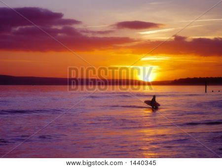 Sunset Surfer At Bournemouth Beach