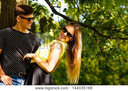 Couple Hugging Under Tree.