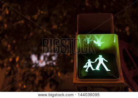 Pedestrian and crossing sign light on for schoolchildren at night